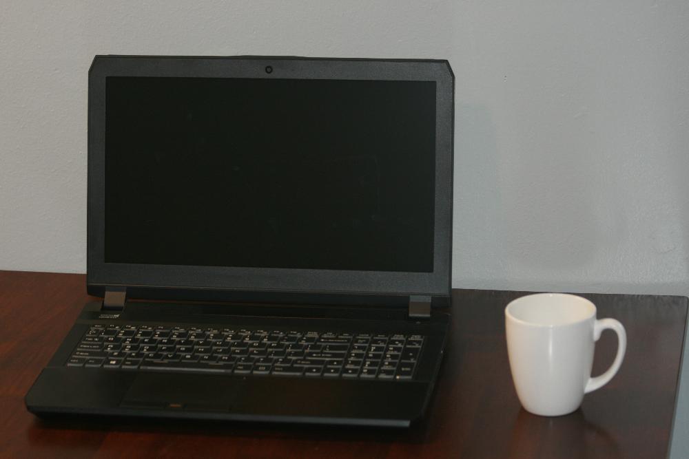Laptop on table with coffee mug