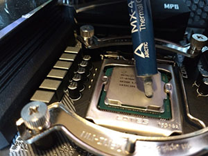 MX-4 thermal paste being applied to cpu