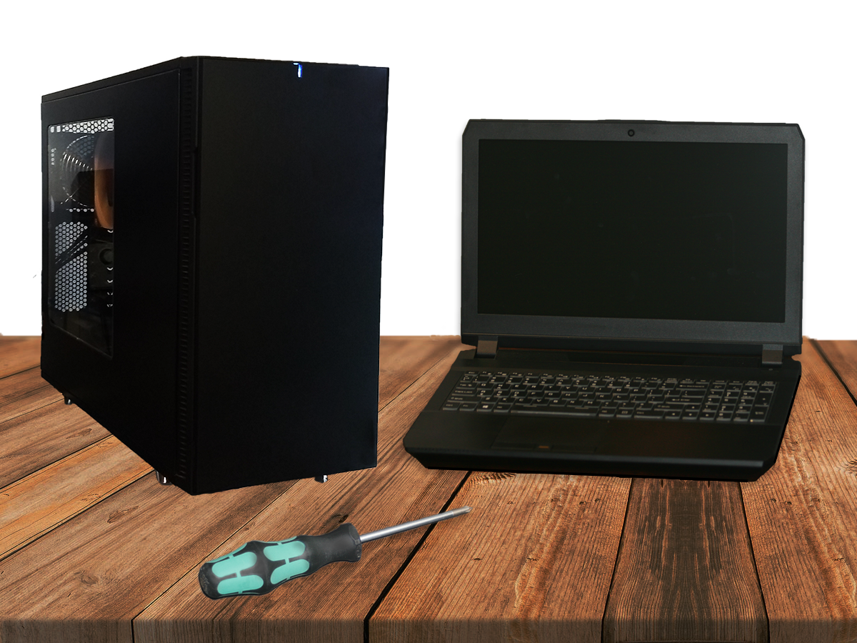 Image of a full computer tower, laptop, and screwdriver on a workbench